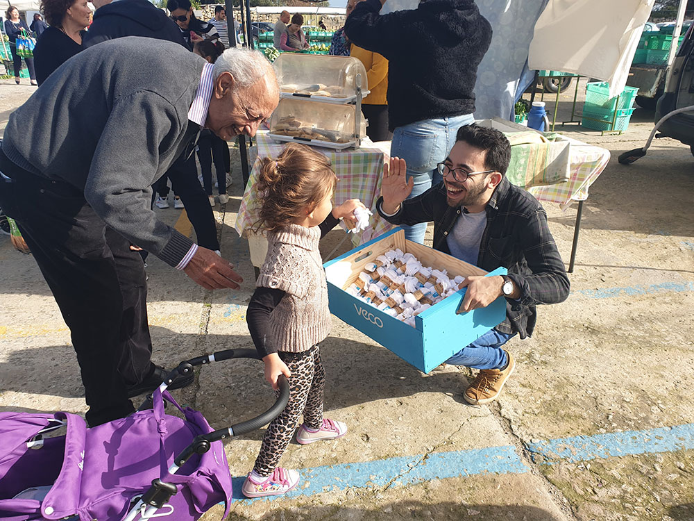 Daniel Testa giving away reusable bags at Ta Qali